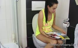 petite brunette pooping over toilet