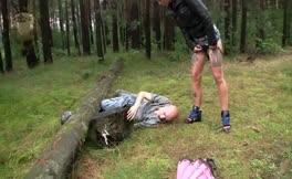 Hot brunette mistress feeds slave outdoor