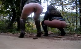 Two horny girls poop together