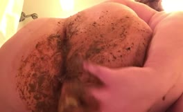 Smearing shit on her big ass