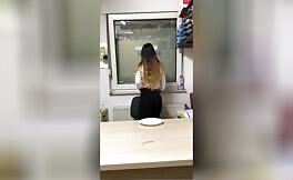 Hot brunette shitting on wooden toilet