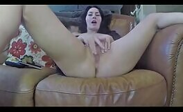 Fingering pussy while pooping on couch