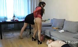 Two sexy girls poop on slave