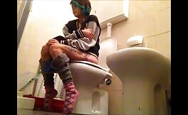 Shaved babe shits a lot over toilet